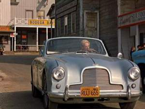 "A 1954 Aston-Martin covertible driven by Tippi Hedren on a street in Bodega Bay in Hitchcock's ""The Birds"""